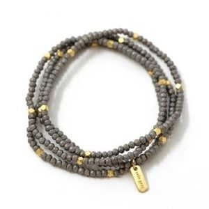 ERIN GRAY GOLD AND WOOD 4 STACK OF BRACELETS